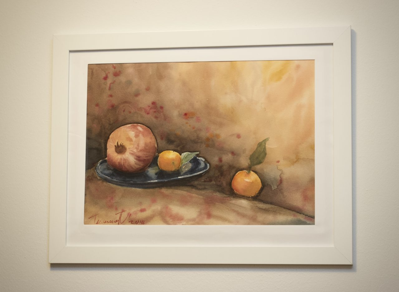 Natura morta with mandarins and pomegranate